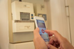 Smart home: man checking electricity consumption on phone